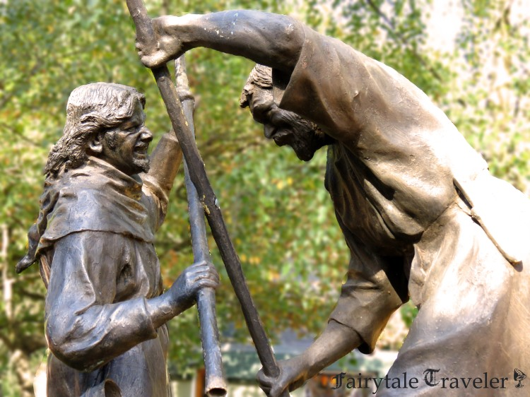 A statue in front of the Visitor's Center of Robin and Little John fighting, by Christa Thompson